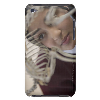 Student looking at animal skeleton barely there iPod case