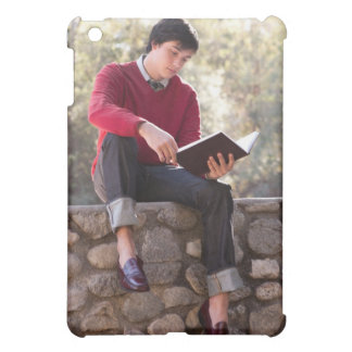 Student Reading Book and Sitting on Stone Wall iPad Mini Cover