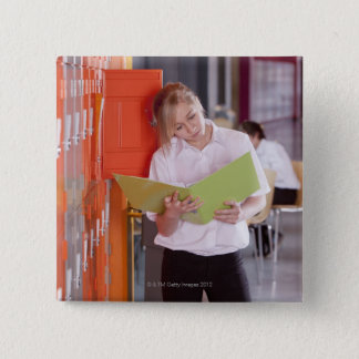 Student removing binder from school locker 15 cm square badge