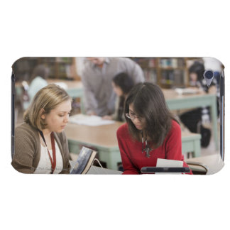 Student talking to librarian in school library iPod touch cases