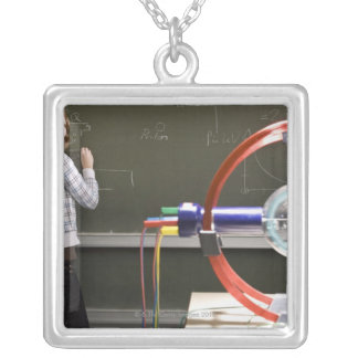 Student writing on blackboard silver plated necklace