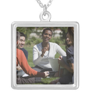 Students with professor silver plated necklace