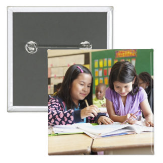 Students working together in classroom buttons