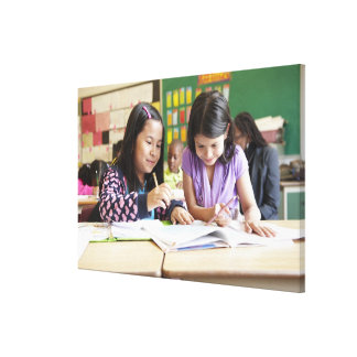 Students working together in classroom canvas prints
