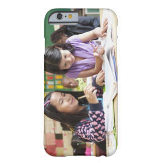 Students working together in classroom barely there iPhone 6 case