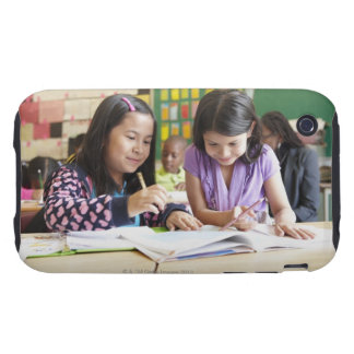 Students working together in classroom tough iPhone 3 cases