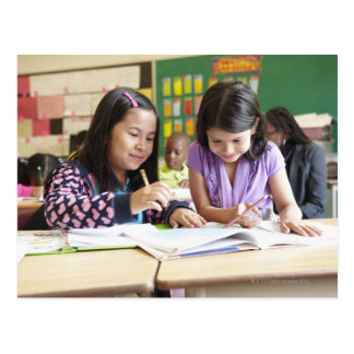 Students working together in classroom postcard