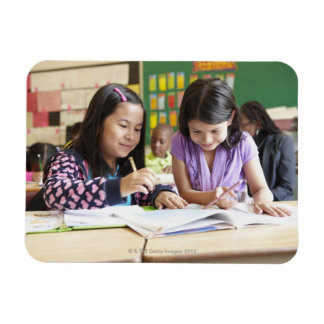Students working together in classroom rectangular photo magnet