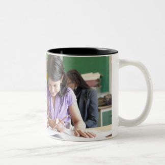 Students working together in classroom Two-Tone mug
