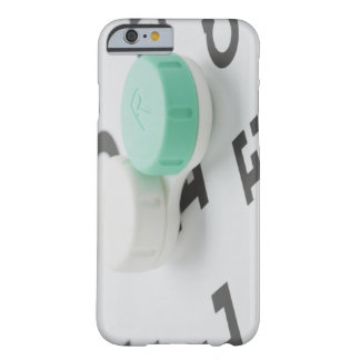 Studio shot of contact lens case on eye chart iPhone 6 case