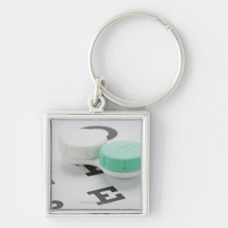 Studio shot of contact lens case on eye chart Silver-Colored square key ring