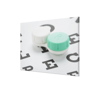 Studio shot of contact lens case on eye chart stretched canvas print
