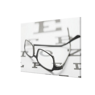 Studio shot of eyeglasses on eye chart gallery wrapped canvas
