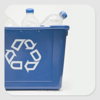 Studio shot of recycling bin with bottles square sticker