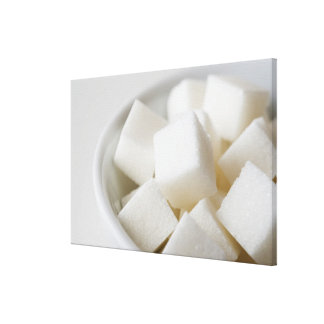 Studio shot of sugar cubes in bowl stretched canvas print