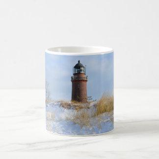 Sturdy Lighthouse on a Rocky Coast in Winter Mug