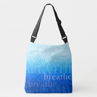 """Styli bag in blue tones with text """"breathe """""""