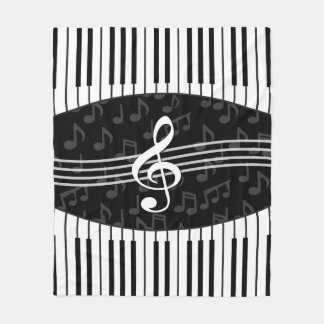 Stylish musical note clef and piano keys fleece blanket