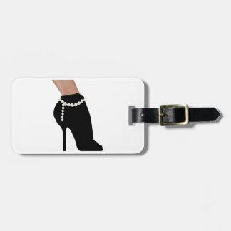 stylish silhouette beautiful woman shoes high heel luggage tag