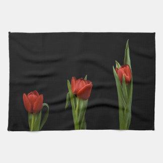 Stylish Vibrant Red Tulips On Black Kitchen Towel