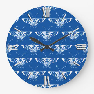 Stylized Art Deco butterfly, cobalt blue and white Clocks