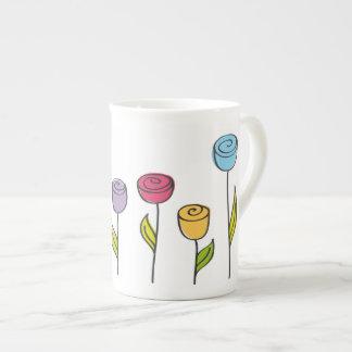 Stylized flowers in various colors bone china mug