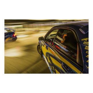Subaru's racing in an underground car park posters