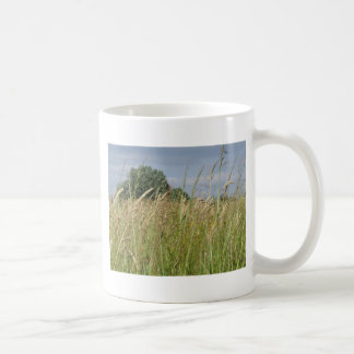 Summer landscape of wild field in the countryside coffee mug