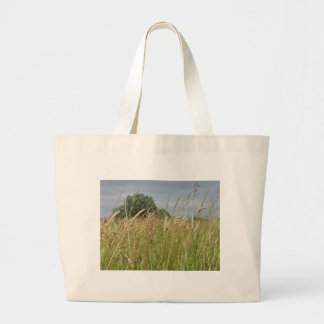 Summer landscape of wild field in the countryside large tote bag