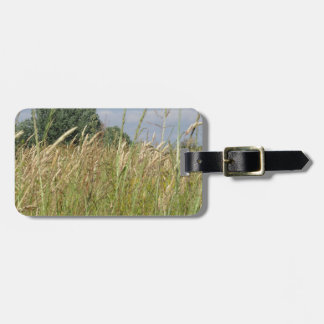 Summer landscape of wild field in the countryside luggage tag