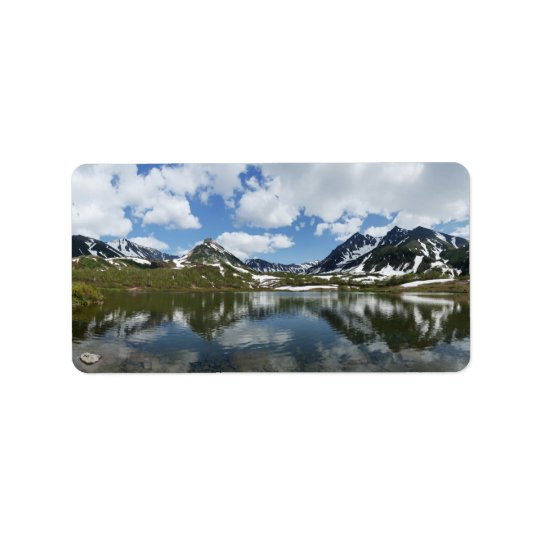 Summer landscape: reflection of mountains in lake label