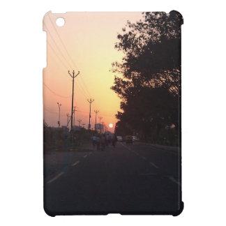 Sun on the road at sunset iPad mini cases