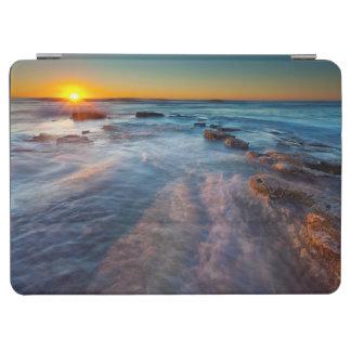 Sun rays illuminate the Pacific Ocean iPad Air Cover