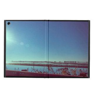 Sun rays over the blue lagoon iPad air covers