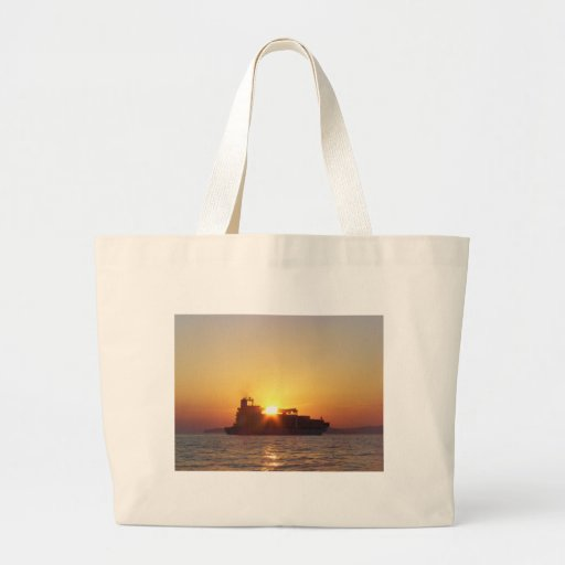 Sun Setting Behind A Container Ship Bags