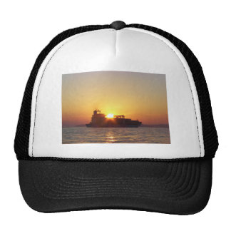 Sun Setting Behind A Container Ship Mesh Hat