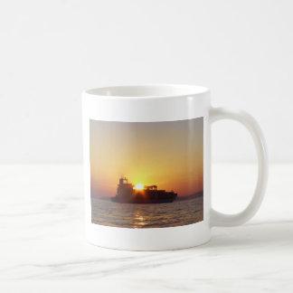 Sun Setting Behind A Container Ship Coffee Mug
