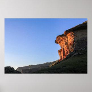 Sun shining on cliff poster