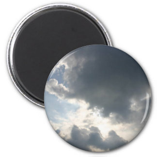 Sun shining through the clouds 6 cm round magnet