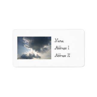 Sun shining through the clouds address label