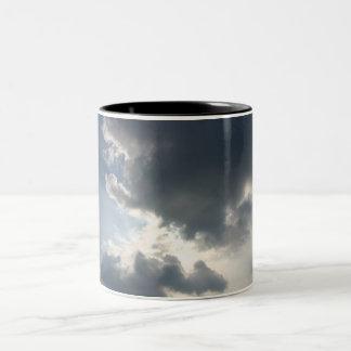 Sun shining through the clouds mug