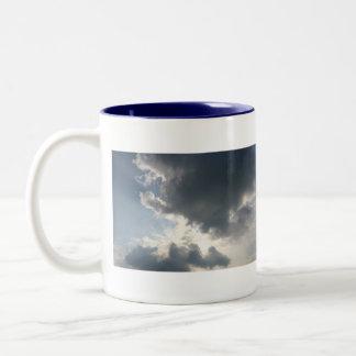 Sun shining through the clouds coffee mug