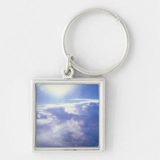 Sun shinning through clouds key chains