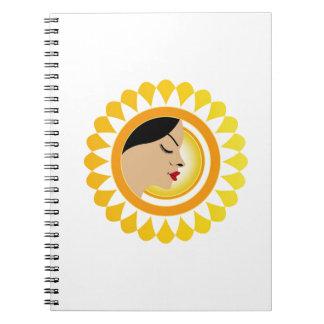 Sun tan- A face with a bright yellow sun Note Book