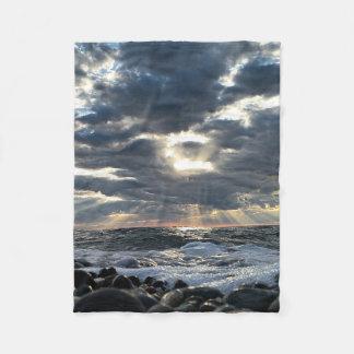 Sunbeams on a Rocky Shore Fleece Blanket