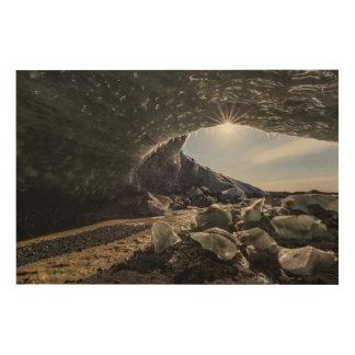 Sunburst at ice cave entrance wood print