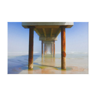 Sunlight and colorful water under an ocean pier canvas print