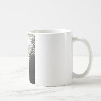 Sunlit tree. coffee mug