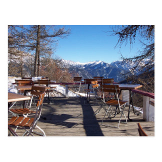 Sunny mountain cafe terrace postcard