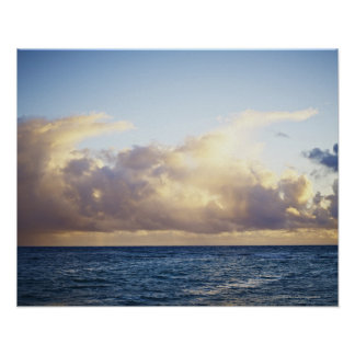 Sunrise and clouds over ocean poster